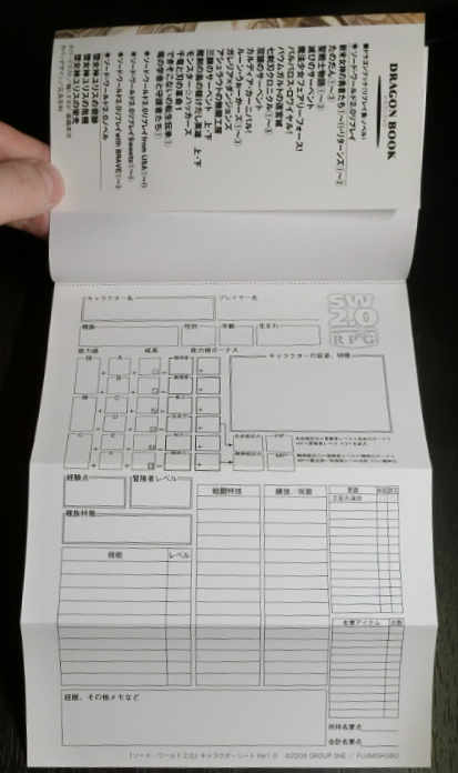 The character sheet folds out from the front of the book.