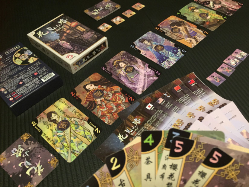 Hanamikoji contents - 7 geisha cards and 7 types of tool cards. Victory and action tokens. Rules in multiple languages