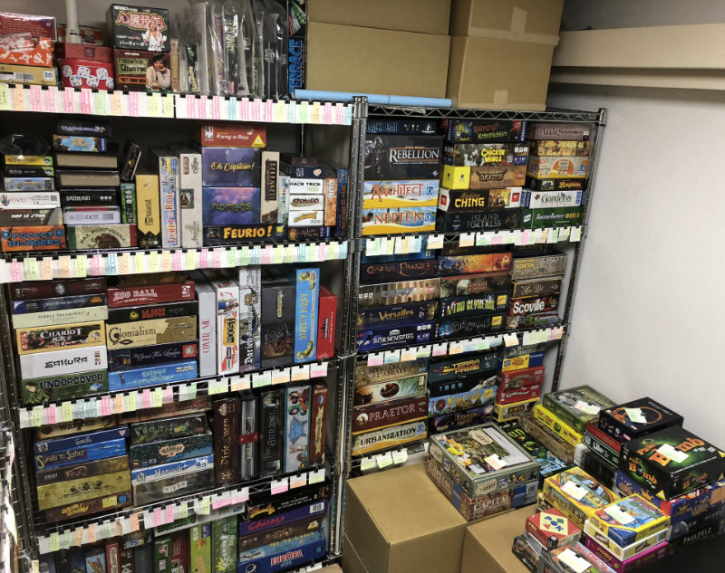 Games on shelves to the left after entering